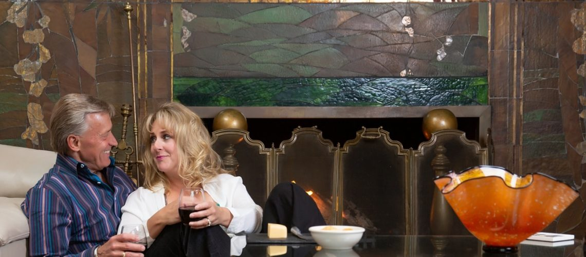 Relax and unwind in front of the fireplace at our Wausau Boutique Hotel